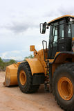 Front end loader. Side view of a front end loader royalty free stock photography