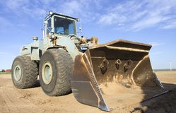 Front end loader. Heavy loader at the work place stock images
