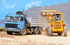 Front end loader and dumper; Graciosa, Canaries. Front end loader and dumper in action; construction of houses on the waterfront of Graciosa island; Northern Stock Images