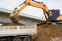 Front end loader dumping stone in a mining quarry Stock Images