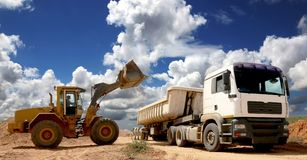 Front End Loader Filling Truck Stock Photos