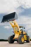 Front end loader machine. One Loader excavator construction machinery equipment over blue sky Stock Images