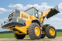 Front end loader machine. One Loader excavator construction machinery equipment over blue sky Stock Image