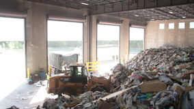 A Front End Loader Moves Trash at a Recycle Center ( 6 of 9) stock footage