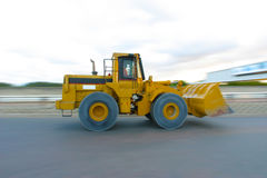 Front end loader moving Royalty Free Stock Images