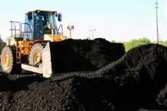 Front End Loader Moving Piles Of Coal Stock Photos