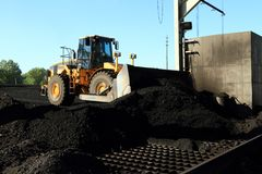 Front End Loader Moving Piles of Coal Royalty Free Stock Image
