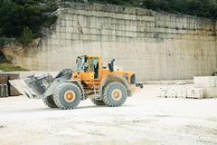 Front-end Loader in a Stone Qu. A huge front-end loader in a limestone quarry stock images