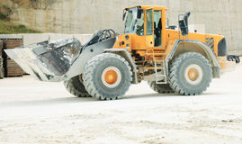 Front-end Loader in a Stone Qu. A huge front-end loader in a limestone quarry royalty free stock photography