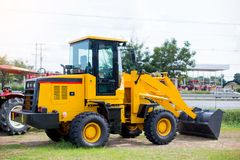 Front end loader tractor for construction stock photos