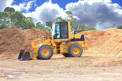 Front end Loader. On wood chip work site Royalty Free Stock Photography