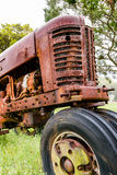 Front end of an old tractor. Front end view of an old abandoned rusty tractor Royalty Free Stock Image