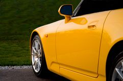 Front End of a Yellow Sportscar. Front end of a yellow sports car Royalty Free Stock Photos