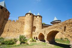 Front entrance of Count`s Castle in Carcassonne. Bridge leading to the front entrance of Count`s Castle in Carcassonne, France stock photography