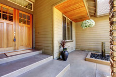 Front entrance door. Exterior of American two story house. With concrete walkway and nice landscape design around. Northwest, USA Stock Images