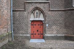 Front entrance with doors of old Dutch church stock image