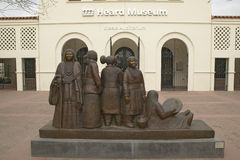 The front entrance of the Heard Museum showing a sculpture of Native Americans in Phoenix, Arizona Stock Photos