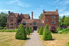 The front entrance to Harvington Hall, Worcestershire, England. The front entrance of the historic Harvington Hall in Worcestershire, England. The path leads to stock image
