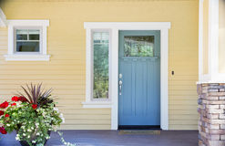 Front entrance of a home with blue door Royalty Free Stock Photo