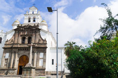 Front entrance to beautiful church of Guapulo located in Quito Ecuador, spanish colonial architecture and blue sky Stock Photography