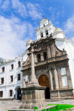 Front entrance to beautiful church of Guapulo located in Quito Ecuador, spanish colonial architecture and blue sky Stock Photos