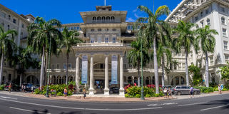 Front exterior panorama of the Moana Surfrider Stock Photography
