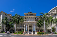 Front exterior panorama of the Moana Surfrider Stock Photos