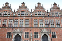 The front facade of four old brick buildings in Gdansk. Royalty Free Stock Photos
