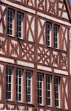 Front facade of a half-timbered house. Detail of a window on a half-timbered house in Trier, Germany. Vertical color image Royalty Free Stock Image