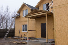 Front facade of a new house under construction Stock Image