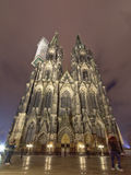 Front facade of the Roman Catholic cathedral of Cologne or High Cathedral of Saint Peter at night. Stock Photo