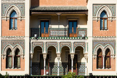 Front facade of a traditional house in Seville. Close-up of the front facade of a traditional house in neo-mudejar style the old area of Seville, Spain Royalty Free Stock Photos