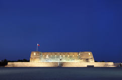 Front facades of Arad fort in blue hours. Arad Fort is a 15th century fort in Arad, Bahrain Royalty Free Stock Photos