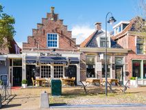 Front facades of historic houses now shops in old town of Workum Stock Image