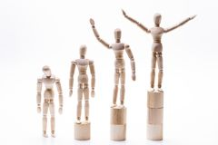 Wooden dolls lined rank order royalty free stock image