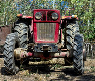 Front of a farm tractor. In a garden Stock Photo