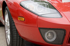 Front Fender - Red Sports Car. Close-up of a right front fender of a bright red sports car royalty free stock images