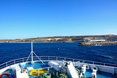 Front of a ferry with view of the Maltese coastline. Bow of the Malita Gozo Channel Line ferry with views towards the Maltese coastline and port, Malta, Europe Stock Images