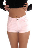 The front few of a young woman in pink shorts Stock Photo