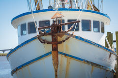Front of fishing boat with anchor. Rusty anchor on front of old fishing boat Royalty Free Stock Photo
