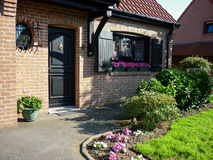 Front flowery house. View of a beautiful and flowery entry of a brick house stock photography