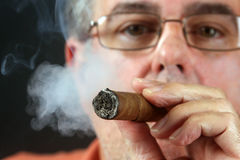 Front focus on a lit cigar Stock Photo