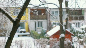Front Focused Shot of Falling Snow. Calm scene with snow flakes falling down from the sky stock video footage