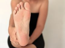 Front Foot Woman Stock Photography