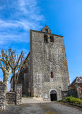 Front of fortified church of Saint-Julien, Nespouls, Correze, Limousin, France stock photos