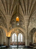 Front foyer of Parliament building. A portion of the front foyer with grand arches and architecture, windows and chairs in the center block of  parliament hill Royalty Free Stock Image