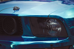Front fragment of blue sport car with headlight Royalty Free Stock Photos