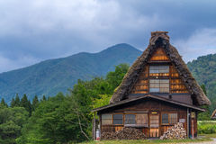 Front of gassho zukuri farm house, Shirakawa Go, Japan. Front of traditional gassho zukuri farm house in Shirakawa Go, Japan under cloudy skies Royalty Free Stock Image