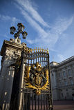 Front Gate Crest at Buckingham Palace. The Front Gate in Buckingham Palace is opening Royalty Free Stock Photography