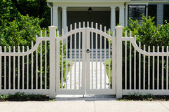 Front Gate and Fence. Front gate and picket fence on elegant house entrance Royalty Free Stock Images